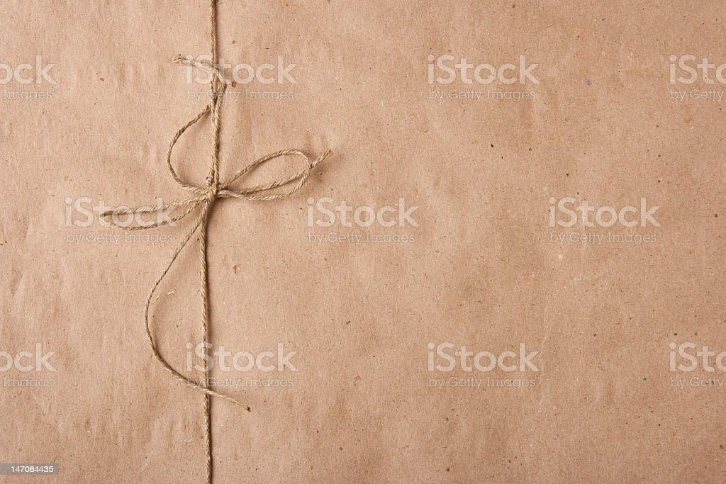 Bow from twine on a packing paper stock photo