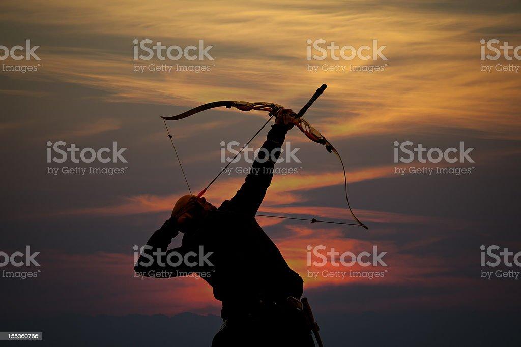 bow hunter sunset silhouette stock photo