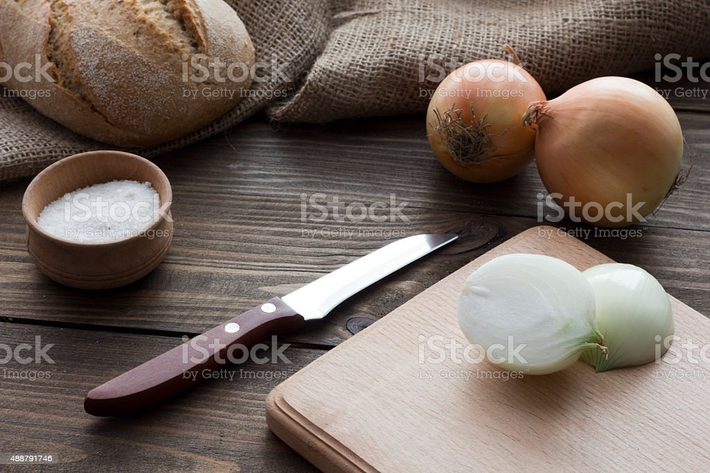Bow , knife , salt and bread stock photo