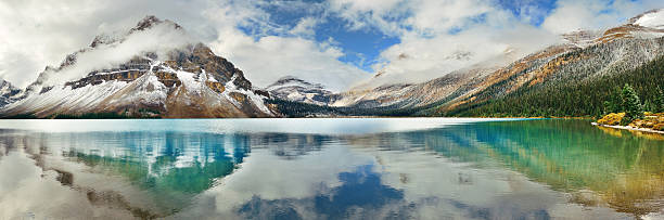 Bow Lake Bow Lake panorama reflection with snow capped mountain and forest in Banff National Park canadian rockies stock pictures, royalty-free photos & images