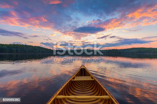 Bow of a cedar canoe on a lake at sunset - Haliburton, Ontario, Canada