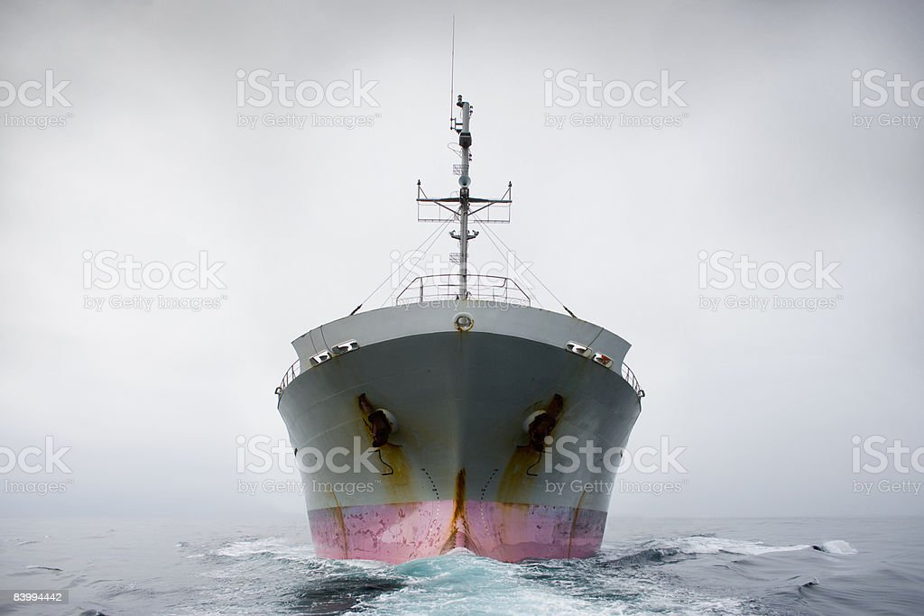 Bow of a pink and grey cargo ship. royalty-free stock photo