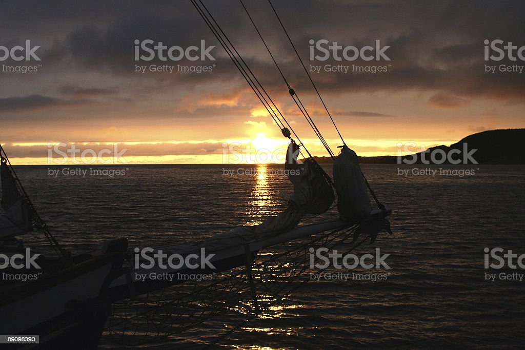 Bow of a Sailing Ship in Sunset royalty-free stock photo