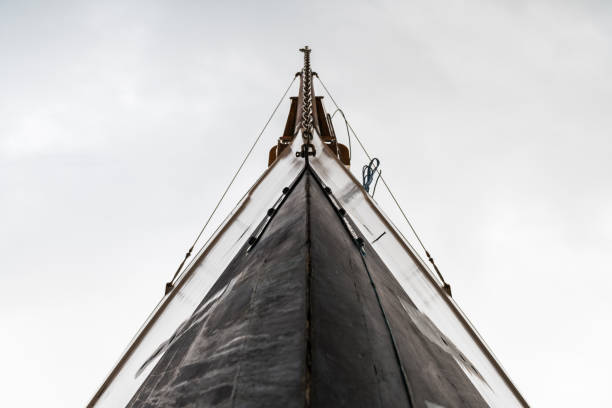 bow of a wooden sail boat - yacht front view stock photos and pictures