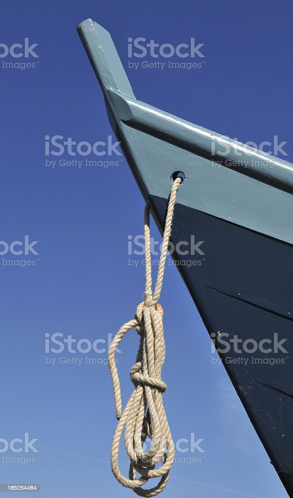 Bow of Blue Boat Against the Sky stock photo