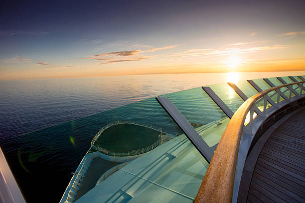 bow of cruise ship at sunset - cruise ship stock photos and pictures