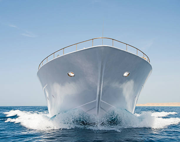 Bow of large motor yacht at sea stock photo