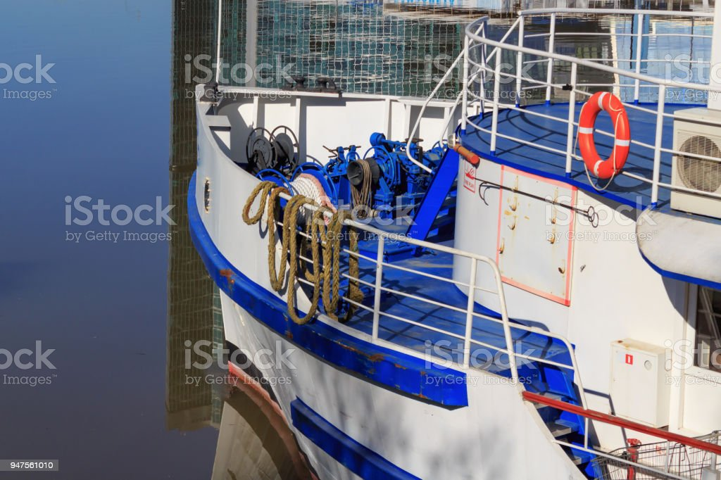 Bow of pleasure boat at the pier closeup stock photo