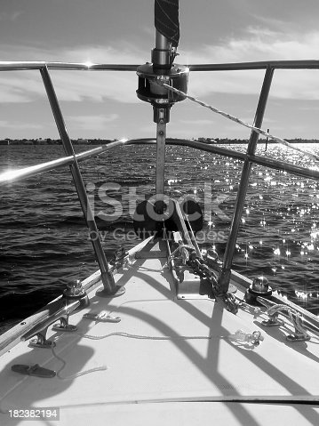 501889762istockphoto Bow of Sailboat Underway as Sunlight Reflects Water and Boat 182382194