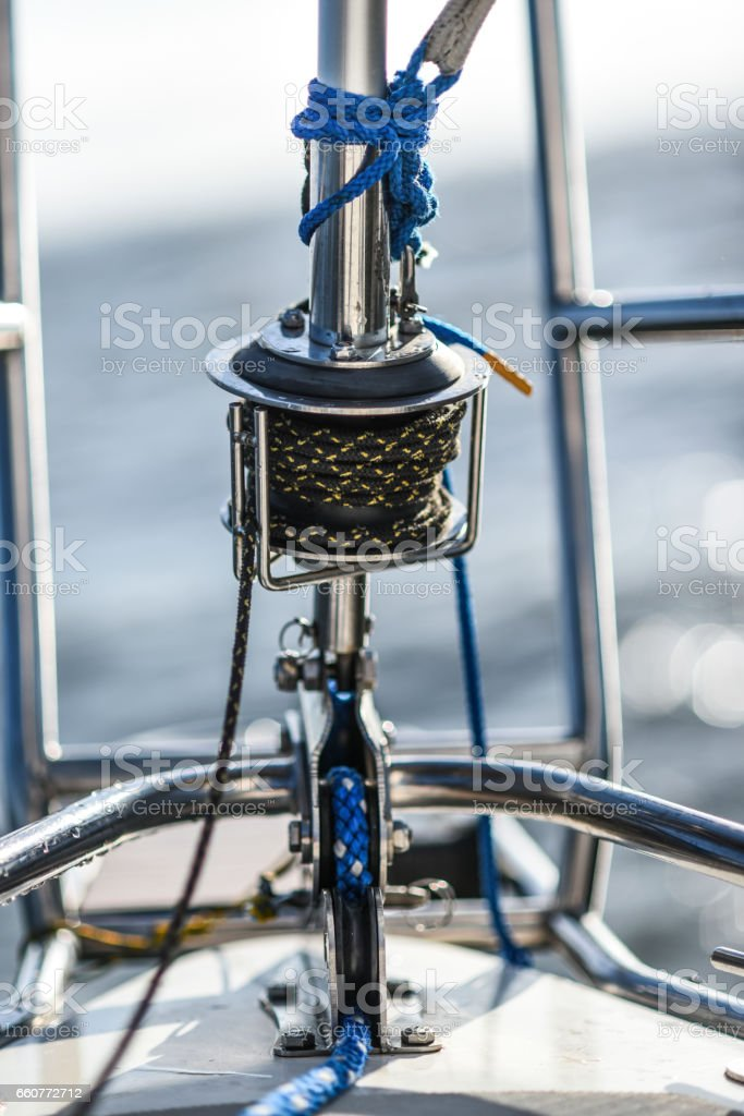 Bow pulpit with jib sail roller and rope on a small sailing boat stock photo