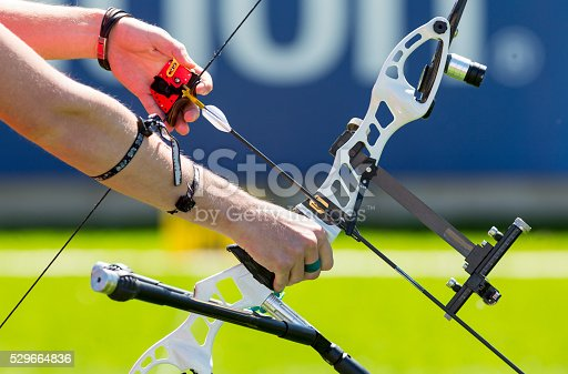 istock Bow shooting hands only 529664836
