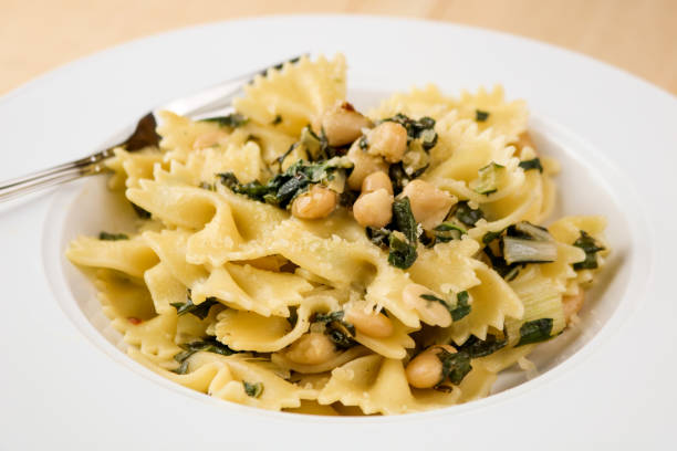 Bow Tie Pasta with Swiss Chard & White Beans stock photo
