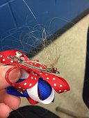 Hair barrette with hair stuck in it