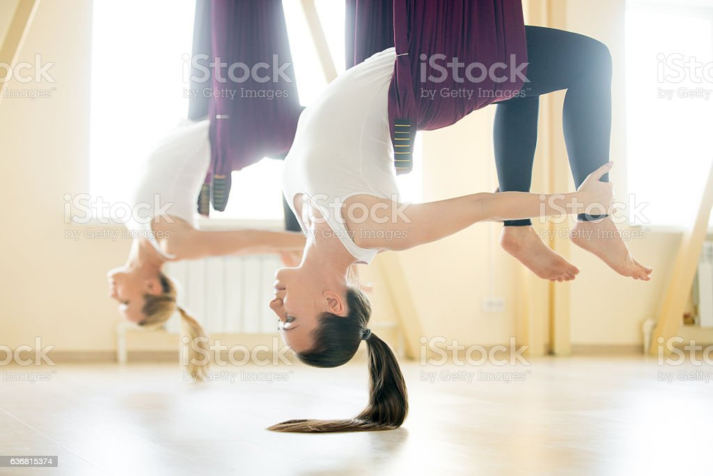 Bow yoga pose in hammock stock photo