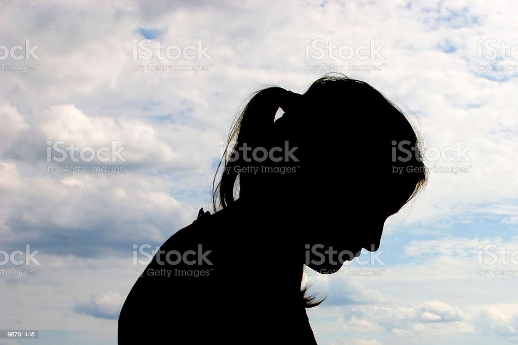 Bowed Head Silhouette royalty-free stock photo