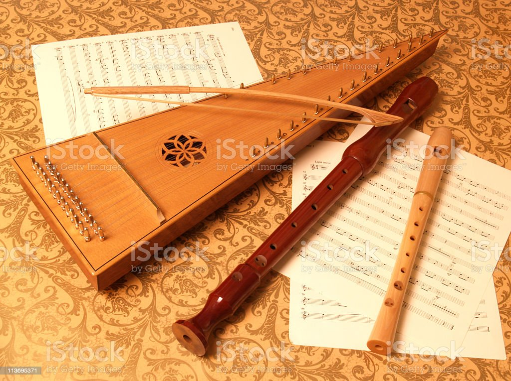 Bowed Psaltery with Recorders on Sheet Music stock photo