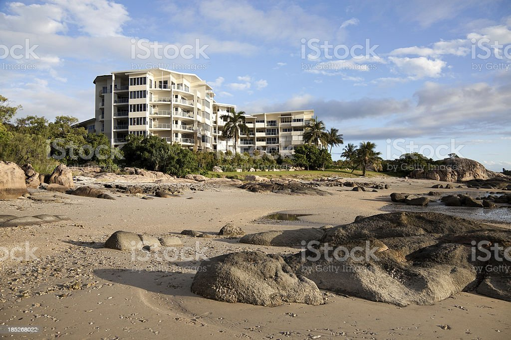 Bowen Apartment Building and Rocky Beach stock photo