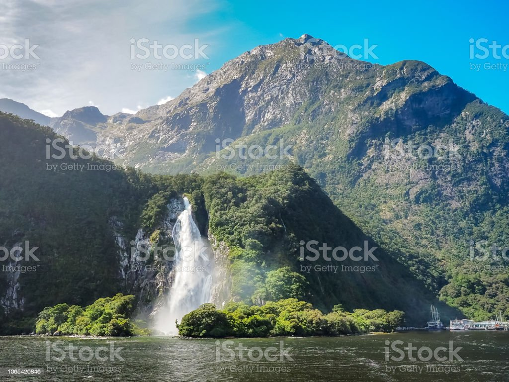 Bowen Falls in Milford Sound, New Zealand. stock photo