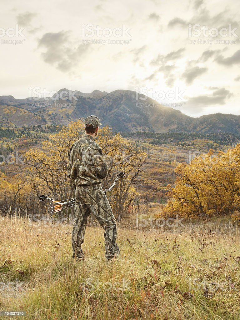 bowhunter at sunrise stock photo