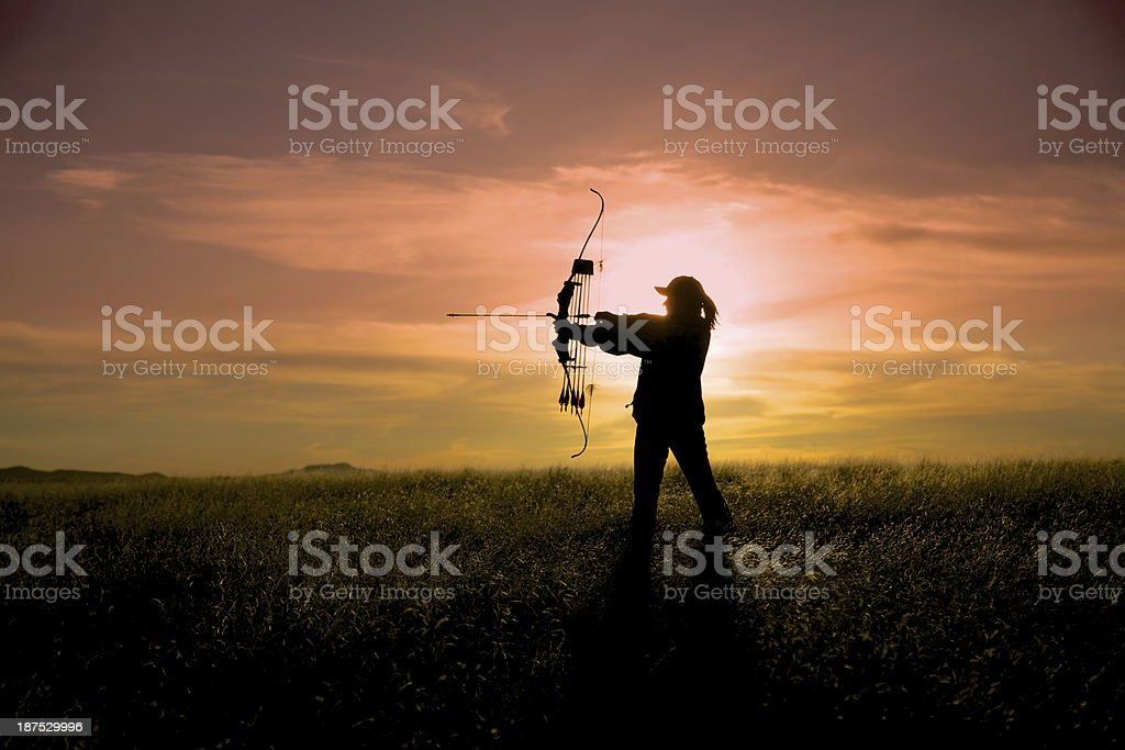 Bowhunter at Sunset stock photo