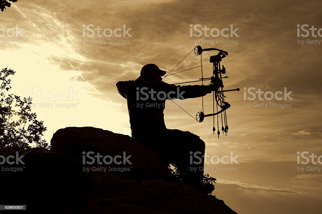 Bowhunter in Sunrise stock photo