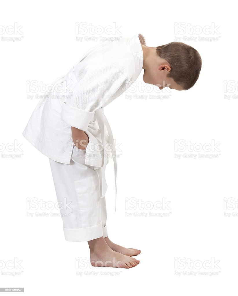 bowing boy in judo kimono, royalty-free stock photo