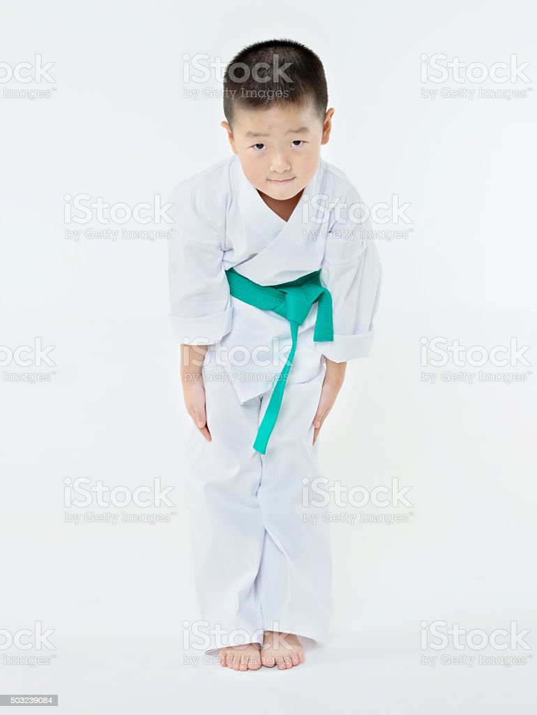 Bowing boy stock photo