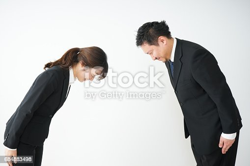 istock A bowing business person 684883498