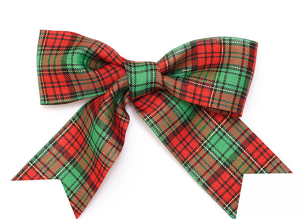 Bowknot with Christmas themed fabric in green & red pattern Bowknot plaid stock pictures, royalty-free photos & images