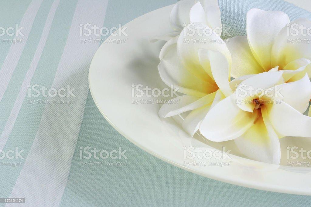bowl and frangipanis royalty-free stock photo