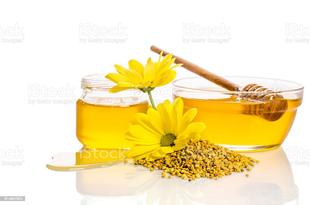 bowl and the jar of honey near a pile of pollen stock photo