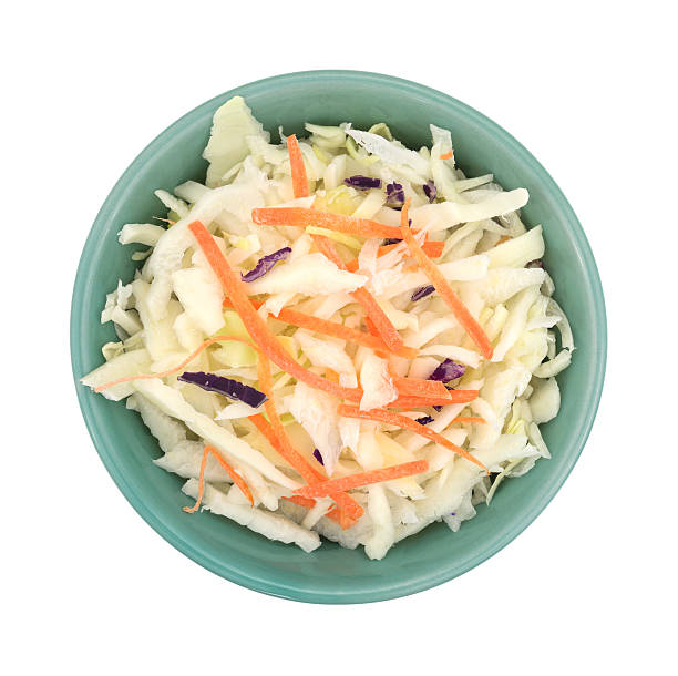 bowl filled with coleslaw on a white background. - coleslaw stock pictures, royalty-free photos & images