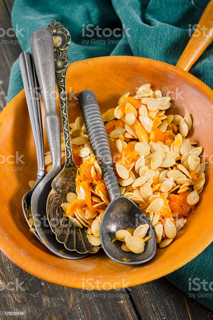 Bowl Filled With Pumpkin Seeds And Vintage Spoons royalty-free stock photo