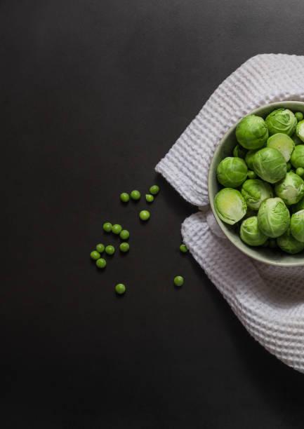 skål full av brysselkål - pea sprouts bildbanksfoton och bilder