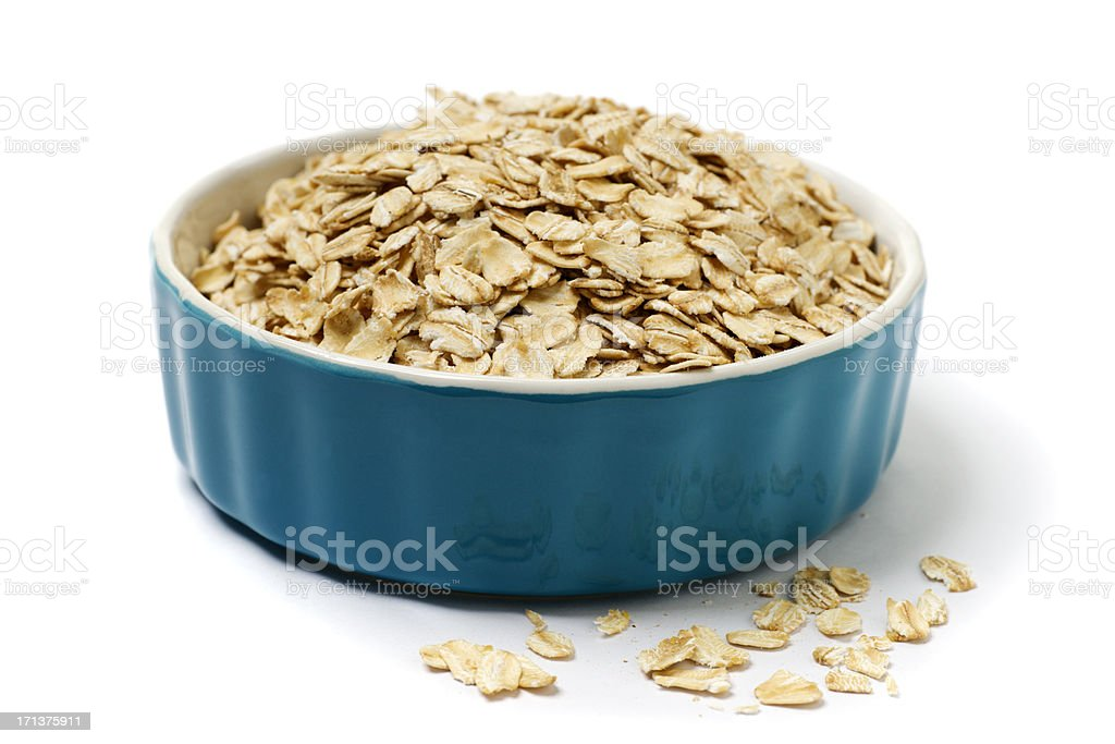 A bowl full of oatmeal flakes. stock photo