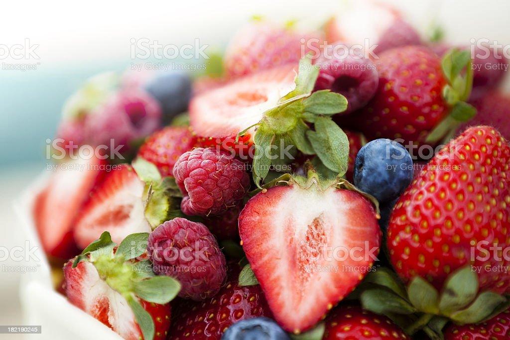 Bowl full of strawberries raspberries and blueberries royalty-free stock photo