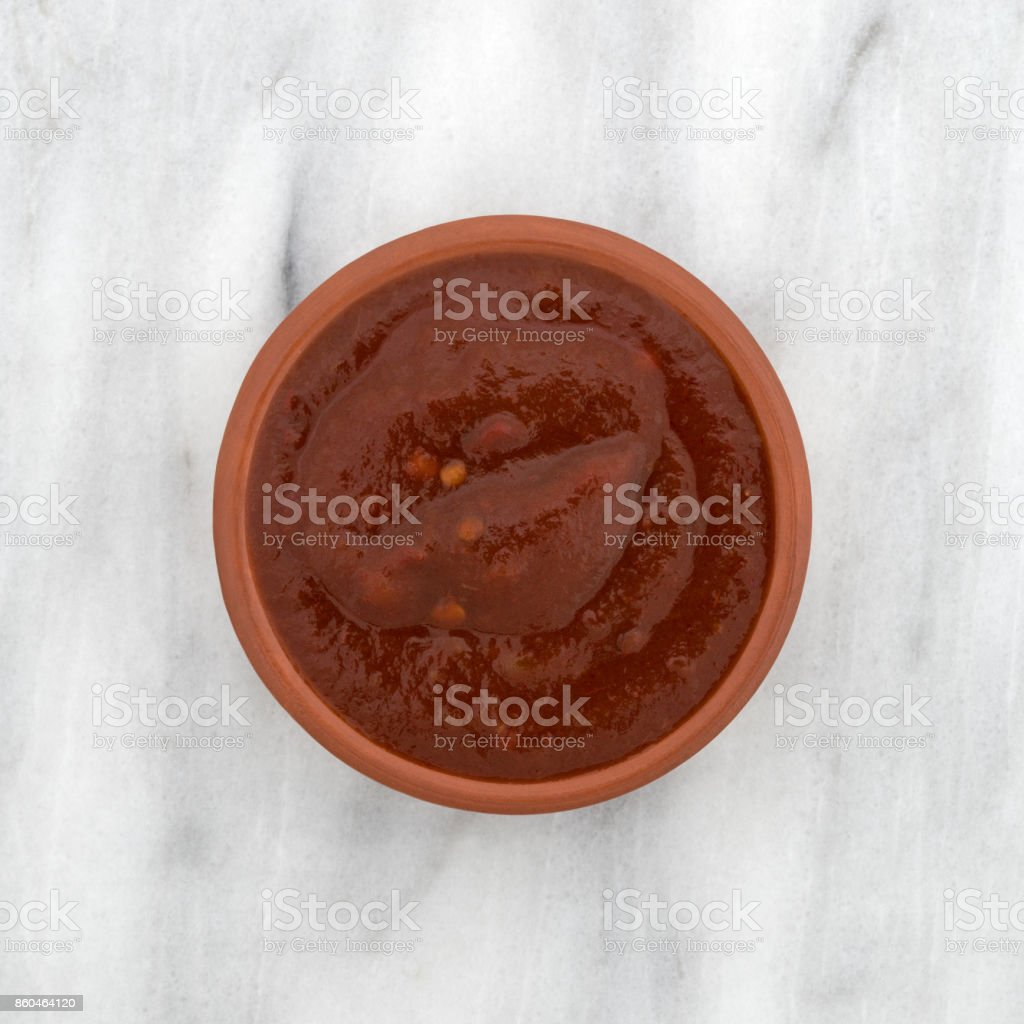 Bowl of adobo sauce on a marble counter top stock photo