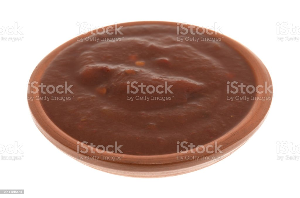 Bowl of adobo sauce on a white background stock photo