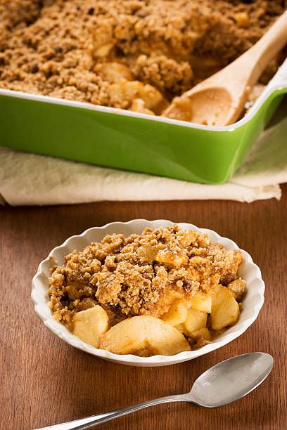 Bowl of Apple Crisp or Apple Crumble with Spoon stock photo