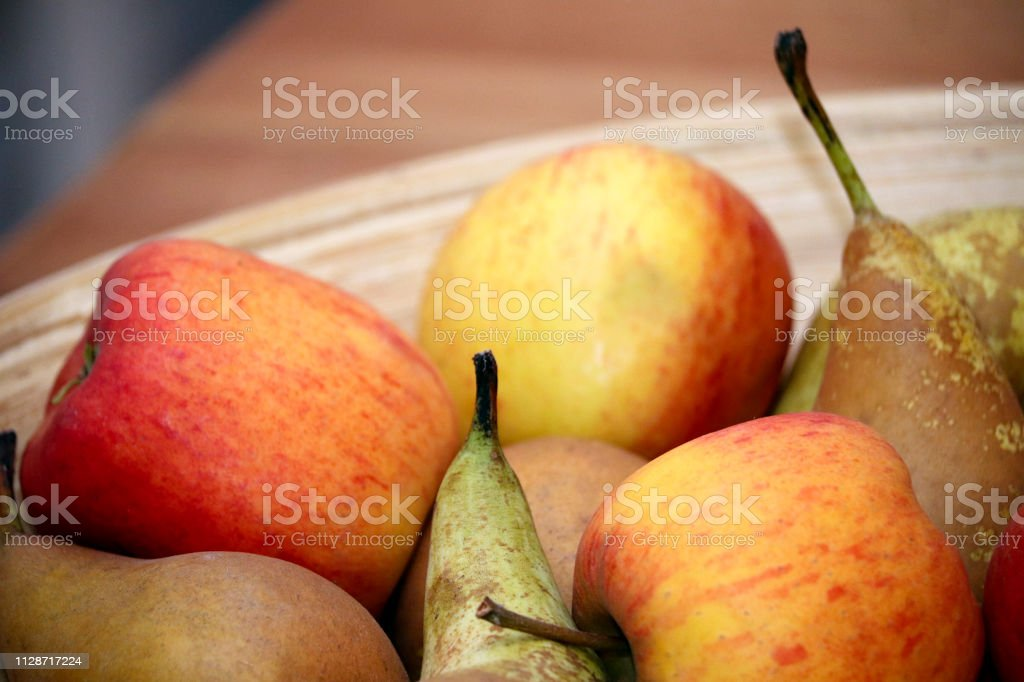 Bowl of apples and pairs stock photo