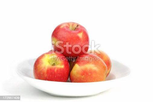 shallow bowl of rosy red apples