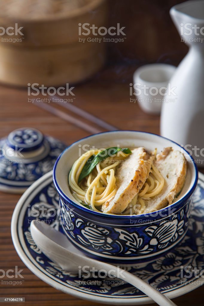 Bowl of Asian chicken noodle soup stock photo