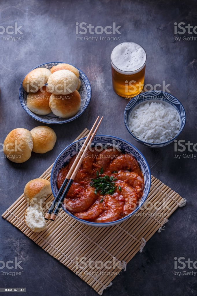 Bowl of asian spicy asian shrimps with beer stock photo