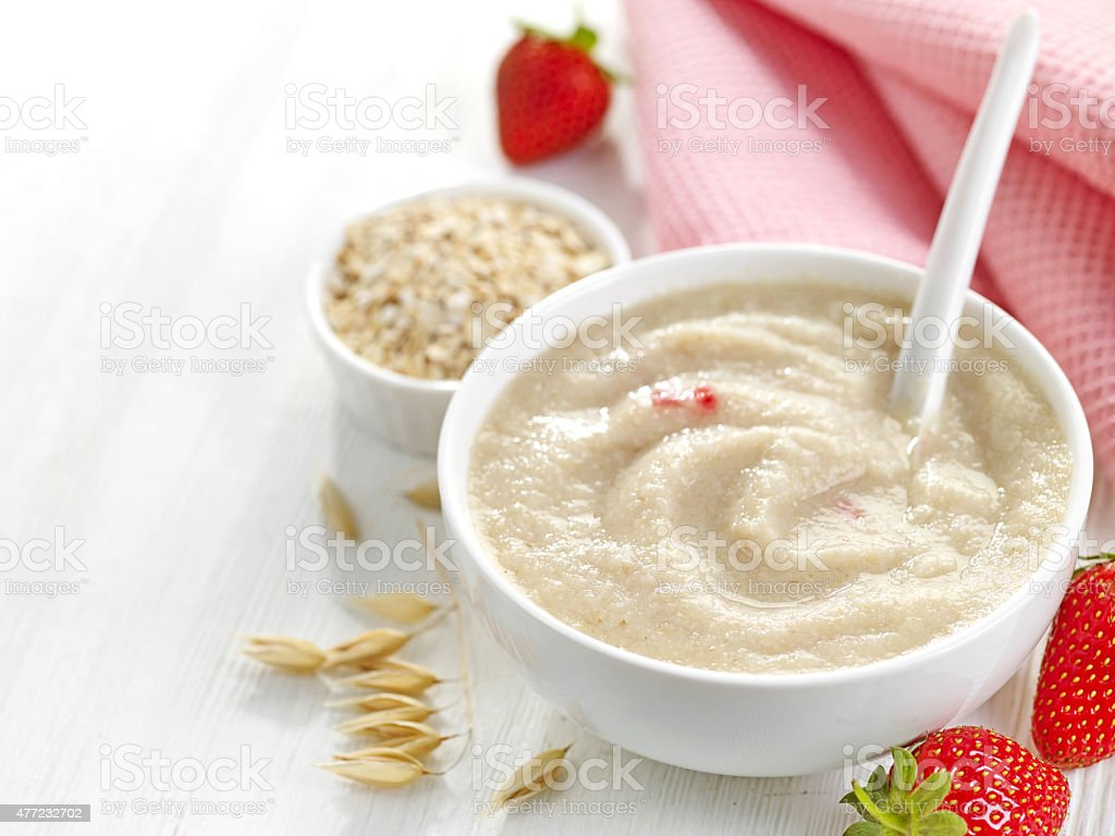 bowl of baby food stock photo