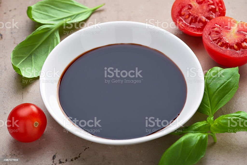 bowl of balsamic vinegar stock photo