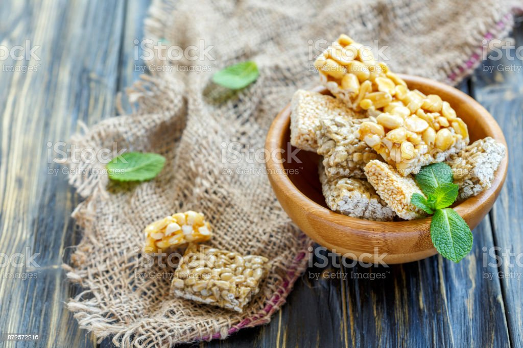 Bowl of bars with sesame, sunflower seeds and peanuts. stock photo
