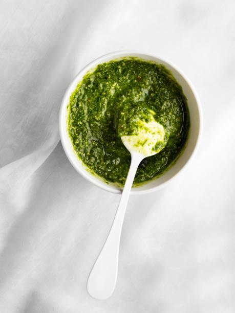 Bowl of basil pesto,Pesto Sauce,Pesto Sauce on White Background stock photo