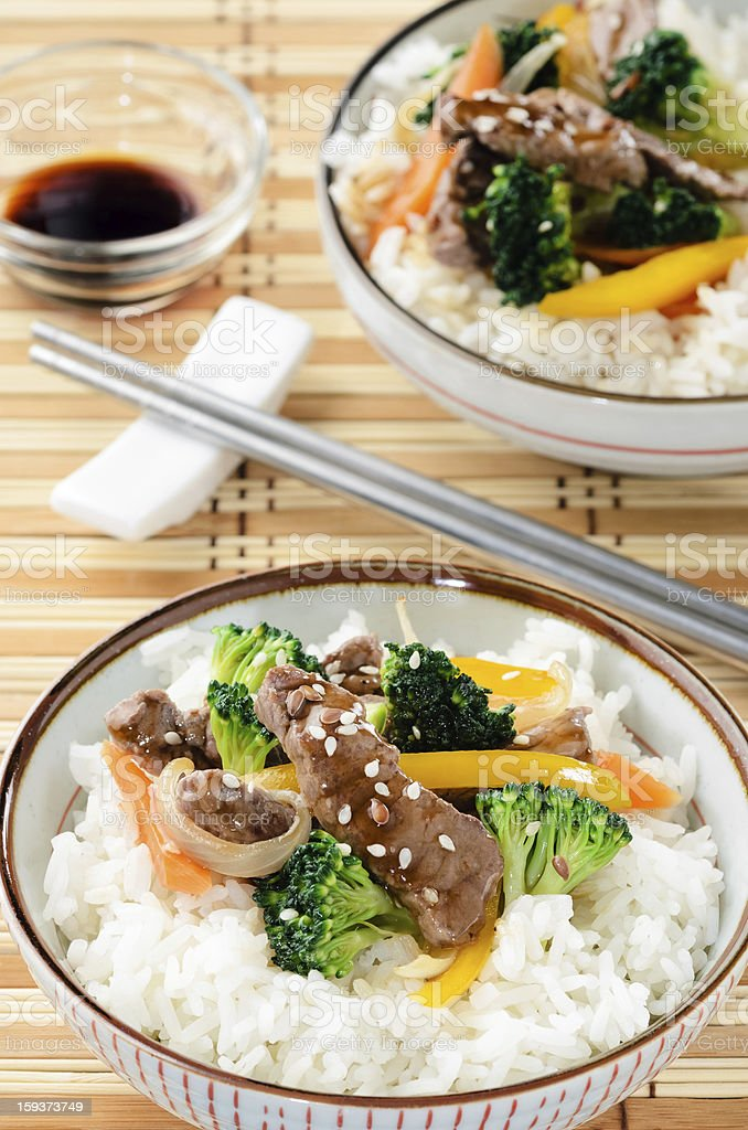 Bowl of beef rice on a bamboo mat stock photo