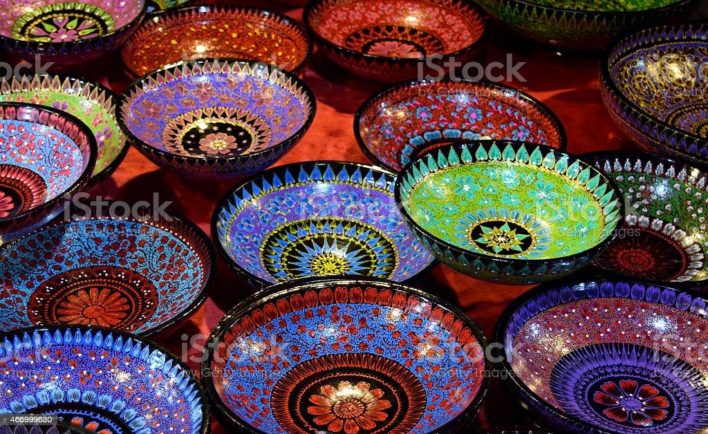 Bowl of black paint floral art stock photo