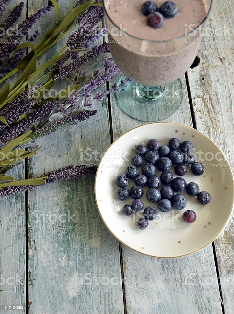 Bowl of Blueberries and Blueberry Smoothie stock photo